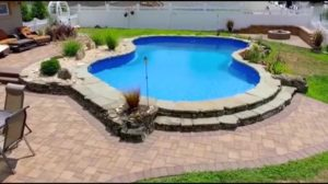 pool surround in brick and stone